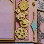 Three gears form a hidden Mickey on the outside of It's a Small World.