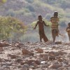 Himba Children Run To See Who The Strangers Are