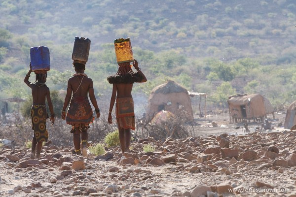 Young Himba Women Carrying Water